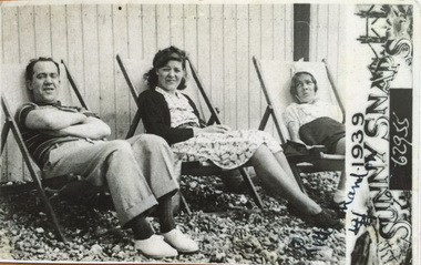 Pop wife and young Renee in deckchairs